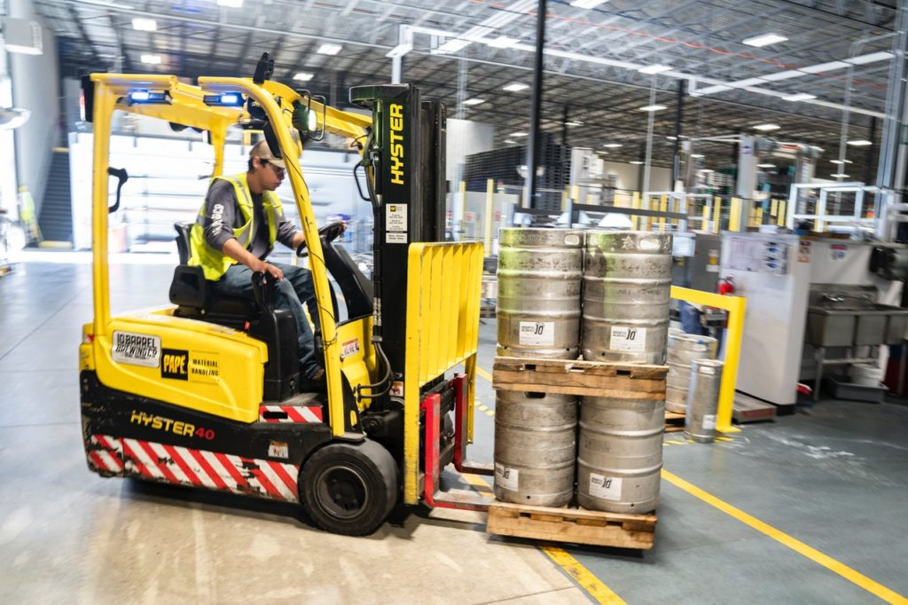 person driving yellow forklift supply chain