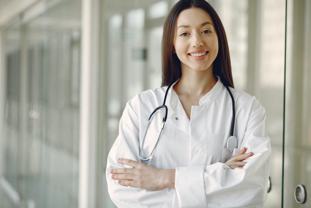 crop doctor in medical uniform with stethoscope standing in 4173251