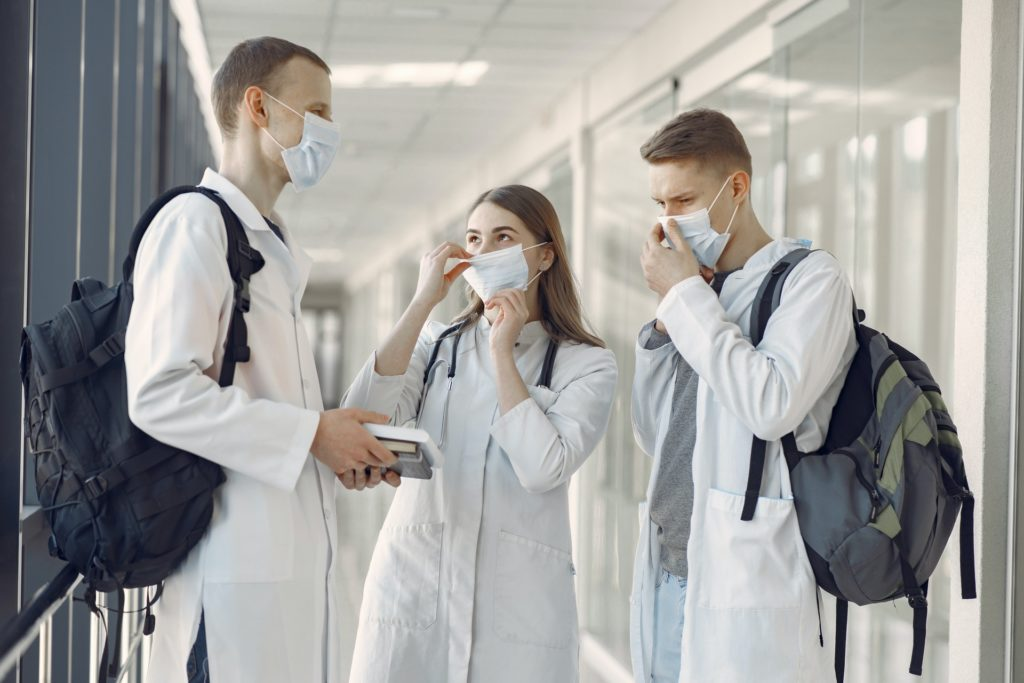 group of medical students at the hallway wearing face mask 3985158