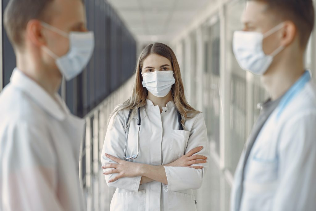 woman in white coat wearing white face mask 3985163