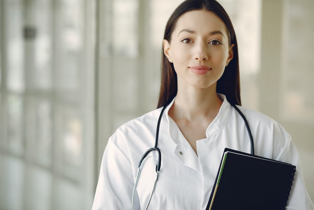 young doctor in uniform with stethoscope and notebook in 4173248